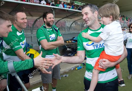 Fermanagh vs Monaghan. Fermanagh manager Rory Gallagher and his son Seanie celebrate after the game