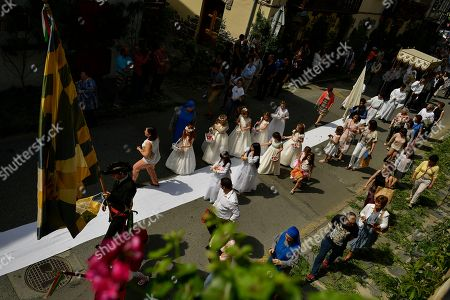 Devotees take part during the Corpus Christi procession, in the small town of Bera de Bidasoa, northern Spain, . The day of Corpus Christi, dated on May 31, has ceased to be a public holiday in Spain. Then, people celebrated today this holy day, an ancient Catholic tradition for fervent believers