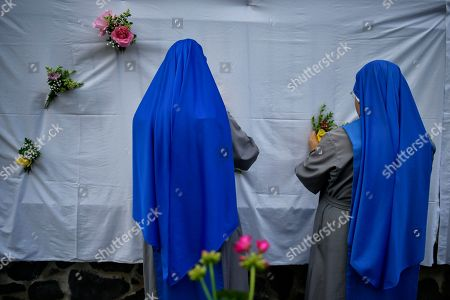 Two nuns arrange some flowers in preparation for the Corpus Christi procession, in the small town of Bera de Bidasoa, northern Spain, . The day of Corpus Christi, dated on May 31, has ceased to be a public holiday in Spain. Then, people celebrated today this holy day, an ancient Catholic tradition for fervent believers