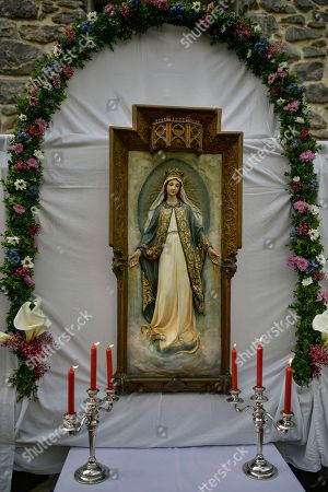 An altar decorated with flowers at the entrance of a house during the Corpus Christi procession, in the small town of Bera de Bidasoa, northern Spain, . The day of Corpus Christi, dated on May 31, has ceased to be a public holiday in Spain. Then, people celebrated today this holy day, an ancient Catholic tradition for fervent believers