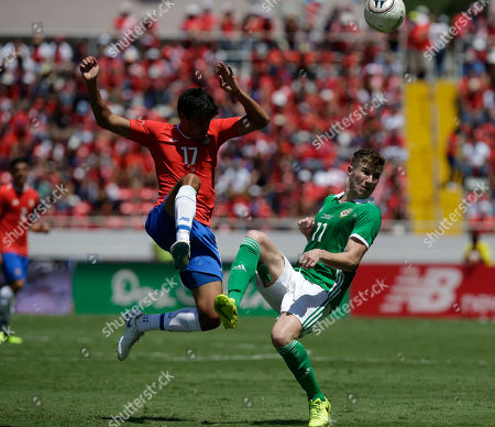 Costa Rica's Yeltsin Tejeda, left, and Northern Ireland's Shayne Lavery fight for the ball during a friendly soccer match between Costa Rica and Northern Ireland in San Jose, Costa Rica