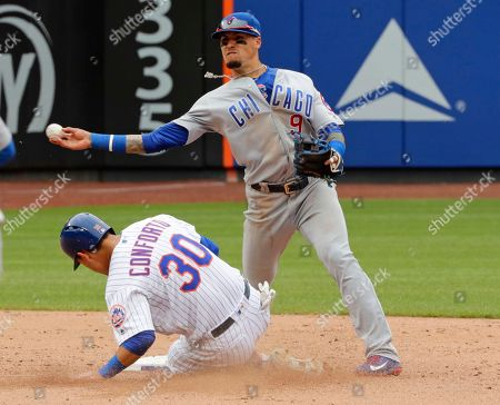 Javier Baez, Michael Conforto. Chicago Cubs second baseman Javier Baez (9) throws out New York Mets' Adrian Gonzalez at first base after forcing out Michael Conforto (30) during the ninth inning of a baseball game, in New York