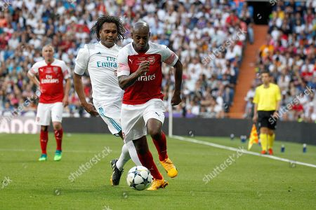 Former Real Madrid's player Christian Karembeu (L) vies for the ball against Former Arsenal's player Boa Morte (R) during the Heart Classic Match 2018 'Soccer for Children' solidarity soccer match between the legends of Real Madrid and Arsenal at the Santiago Bernabeu Stadium, in Madrid, Spain, 03 June 2018.