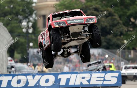 Arie Luyendyk Jr. takes the jump on turn eight during the Super Truck Series auto race, in Detroit