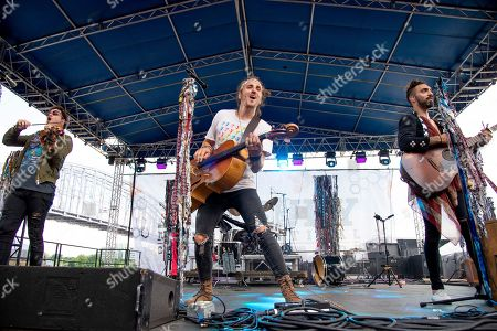 Zambricki Li, Austin Bisnow, Zang. Zambricki Li, from left, Austin Bisnow and Zang of Magic Giant performs at the Bunbury Music Festival, in Cincinnati