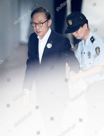 South Korean Former President Lee Myung-bak arrives at a court in Seoul, South Korea, 04 June 2018, to attend the second hearing in his trial on alleged corruption.
