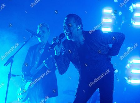 """Dave Gahan, Martin Gore. Dave Gahan, left, and Martin Gore of the band Depeche Mode perform in concert during their """"Global Spirit Tour"""" at The Wells Fargo Center, in Philadelphia"""