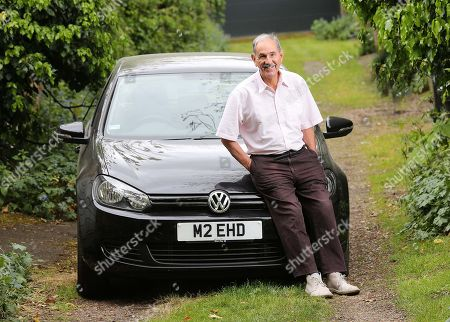 Editorial image of Writer Hunter Davies With His Vw Golf.