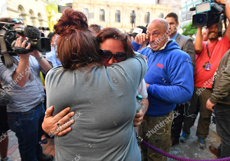 Editorial image of Mother Of Deceased Teenager Olivia Campbell Charlotte Campbell With Partner Paul Hodgson Place Tributes In St.ann's Sq Manchester.- Manchester Arena Ariana Grande Concert Bombing By Is Terrorist Salman Abedi Manchester. Pic Bruce Adams / Copy Tozer