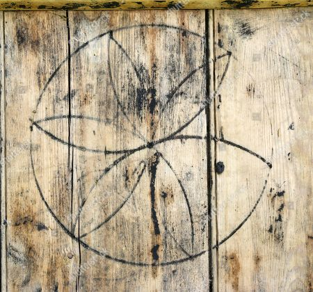 Former Bbc Correspondent Michael Cole Discovers His Old Garage Door Has Markings That Depict Ancient Black Magic And Witches Curses. A Complete Hexafoil Symbol Taken From Michael's Door.