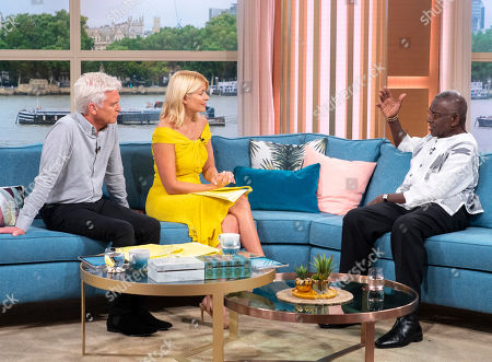 Phillip Schofield and Holly Willoughby with Rudolph Walker