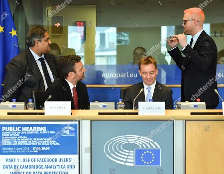 Christopher Whylie, right, speaks with the Chair of the Committee on Civil Liberties, Justice and Home Affairs of the European Parliament Claude Moraes, left, as they attend a public hearing regarding the use of Facebook users data by Cambridge Analytica and its impact on data protection at the European Parliament in Brussels