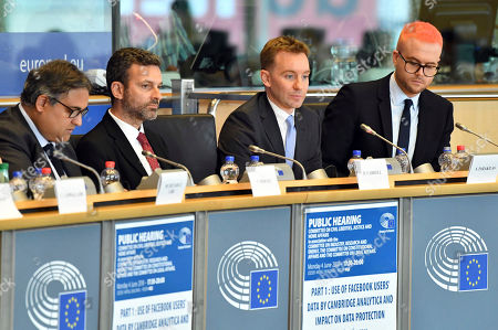 From left, Chair of the Committee on Civil Liberties, Justice and Home Affairs of the European Parliament Claude Moraes, David Caroll, associate professor at Parsons School Design, Sandy Parakalis and Christopher Whylie attend a public hearing regarding the use of Facebook users data by Cambridge Analytica and its impact on data protection at the European Parliament in Brussels