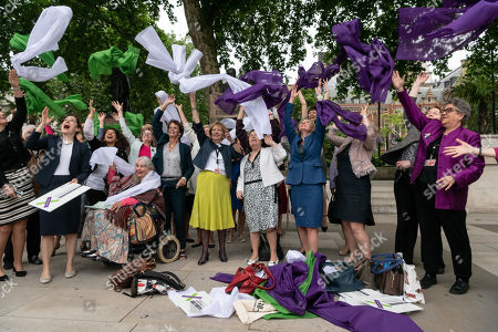 Female politicians including Maria Miller and Justine Greening stand next to a statue of suffragette Millicent Fawcett to launch Processions, the UK's largest ever artwork created by women.