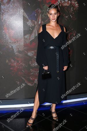 Actress Renee Stewart poses for photographers upon arrival at the premiere of McQueen in central London