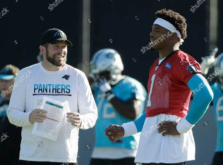 Cam Newton, Scott Turner. Carolina Panthers' Cam Newton, right, talks with quarterbacks coach Scott Turner, left, during the NFL football team's practice in Charlotte, N.C