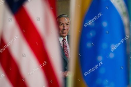The portrait of former Secretary of State Warren Christopher is seen through a Brazilian and United States flags as Secretary Mike Pompeo meets with Brazilian Foreign Minister Aloysio Nunes Ferreira at the State Department in Washington