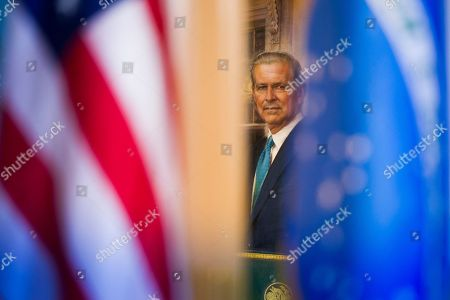 The portrait of former Secretary of State James Baker is seen through a Brazilian and United States flags as Secretary Mike Pompeo meets with Brazilian Foreign Minister Aloysio Nunes Ferreira at the State Department in Washington