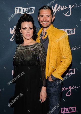 """Debi Mazar, left, and Gabriele Corcos attend TV Land's """"Younger"""" Season 5 premiere party at Cecconi's, in New York"""