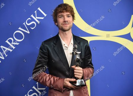 Sander Lak poses in the winner's walk with the emerging talent award at the CFDA Fashion Awards at the Brooklyn Museum, in New York