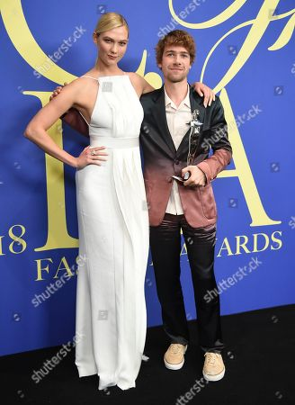 Karlie Kloss, Sander Lak. Karlie Kloss, left, and Sander Lak, winner of the emerging talent award, pose in the winner's walk at the CFDA Fashion Awards at the Brooklyn Museum, in New York