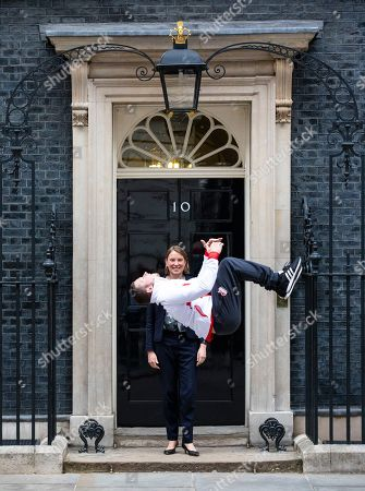Stock Picture of Gold medal winning gymnast Dominick Cunningham performs a backflip in front of Sports Minister Tracey Crouch MP outside 10 Downing Street.