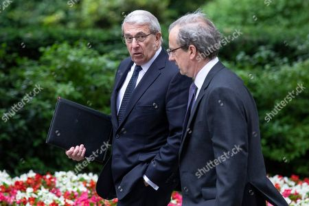 Chairman of BAE Systems Sir Roger Carr (L) arrives on Downing Street