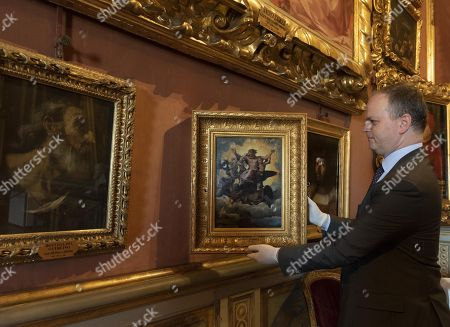 The director of the Uffizi Gallery Eike Schmidt shows 'La visione di Ezechiele' (The Vision of Ezekiel) (C) by Italian painter Raffaello in the occasion of the new staging of works by Raffaello at Palazzo Pitti, in Florence, Italy, 05 June 2018.