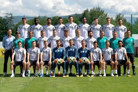 The German national soccer team (front row, L-R) Sebastian Rudy, Marco Reus, Timo Werner, goalkeeper Kevin Trapp, goalkeeper Manuel Neuer, goalkeeper Marc-Andre ter Stegen, Mesut Oezil, Joshua Kimmich, and Ilkay Guendogan; (middle row, L-R) team manager Oliver Bierhoff, head coach Joachim Loew, assistant coach Thomas Schneider, Toni Kroos, Julian Draxler, Thomas Mueller, Julian Brandt, Marvin Plattenhardt, assistant coach Marcus Sorg, goalkeeper coach Andreas Koepke, and assistant coach Mirosloav Klose; (back row, L-R) Mario Gomez, Antonio Ruediger, Sami Khedira, Mats Hummels, Niklas Suele, Jerome Boateng, Leon Goretzka, Matthias Ginter, and Jonas Hector pose for a group photo in Eppan, Italy, 05 June 2018. The German squad prepares for the upcoming FIFA World Cup 2018 at a training camp in Eppan until 07 June 2018.