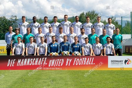 The German national soccer team (front row, L-R) Sebastian Rudy, Marco Reus, Timo Werner, goalkeeper Kevin Trapp, goalkeeper Manuel Neuer, goalkeeper Marc-Andre ter Stegen, Mesut Oezil, Joshua Kimmich, and Ilkay Guendogan; (middle row, L-R) team manager Oliver Bierhoff, head coach Joachim Loew, assistant coach Thomas Schneider, Toni Kroos, Julian Draxler, Thomas Mueller, Julian Brandt, Marvin Plattenhardt, assistant coach Marcus Sorg, goalkeeper coach Andreas Koepke, and assistant coach Miroslav Klose; (back row, L-R) Mario Gomez, Antonio Ruediger, Sami Khedira, Mats Hummels, Niklas Suele, Jerome Boateng, Leon Goretzka, Matthias Ginter, and Jonas Hector pose for a group photo in Eppan, Italy, 05 June 2018. The German squad prepares for the upcoming FIFA World Cup 2018 in Russia at a training camp in Eppan until 07 June 2018.