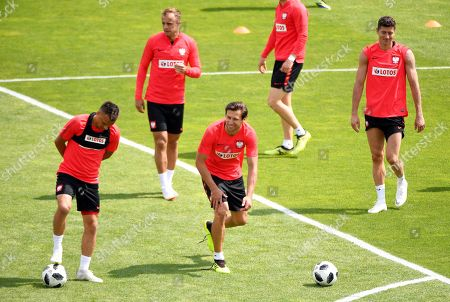 Polish national soccer team players (L-R) Slawomir Peszko, Kamil Grosicki, Grzegorz Krychowiak, and Robert Lewandowski perform during their team's training session in Arlamow, Poland, 05 June 2018. The Polish team prepares for the FIFA World Cup 2018 taking place in Russia from 14 June until 15 July 2018.