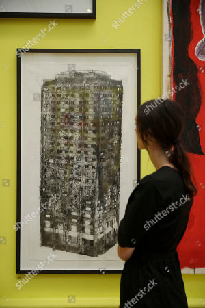 """A woman poses for photographs in front of """"Five Grand"""" by artist Luke Wade which shows the burnt out Grenfell Tower and features in this year's Summer Exhibition on it's 250th year at the Royal Academy of Arts in London, . The Summer Exhibition has been held since 1769, with around 1300 works on display this year and most of them available for purchase. It runs from June 12 until August 19"""