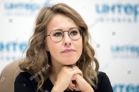 On, former presidential candidate and TV star Ksenia Sobchak attends a news conference in Moscow, Russia
