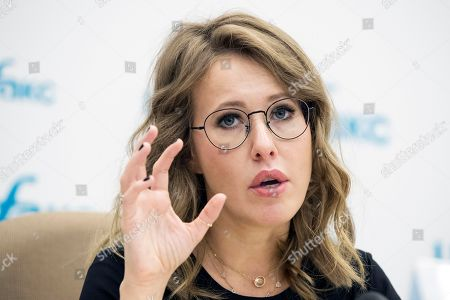 On, former presidential candidate and TV star Ksenia Sobchak speaks during a news conference in Moscow, Russia