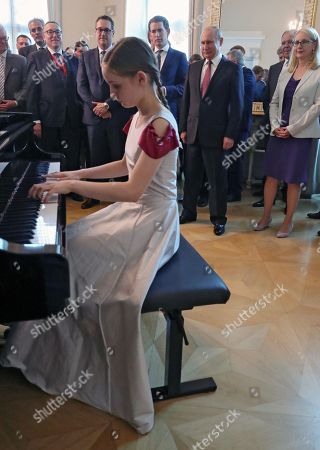 Stock Photo of Russian President Vladimir Putin (back 2-R) and Austrian Chancellor Sebastian Kurz (back 3-R) listen as 13-year-old composer, violinist and pianist Alma Deutscher (front) performs during their meeting in Vienna, Austria, 05 June 2018. Vladimir Putin is on a one-day visit in Austria.