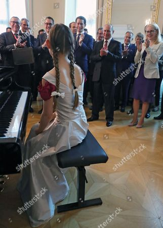 Russian President Vladimir Putin (back, 1st row, 2-R) and Austrian Chancellor Sebastian Kurz (back, 1st row, 3-R) applaud to 13-year-old composer, violinist and pianist Alma Deutscher (front) after her performing during their meeting in Vienna, Austria, 05 June 2018. Vladimir Putin is on a one-day visit in Austria.