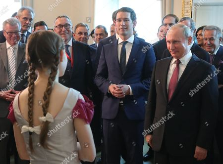 Russian President Vladimir Putin (front R) and Austrian Chancellor Sebastian Kurz (front 2-R) talk to 13-year-old composer, violinist and pianist Alma Deutscher (front, back to camera) during their meeting in Vienna, Austria, 05 June 2018. Vladimir Putin is on a one-day visit in Austria.