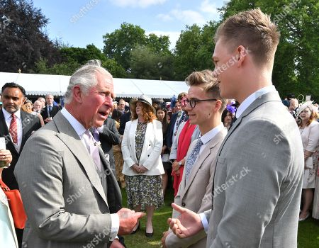 Stock Image of Prince Charles meets YouTube vloggers Joe Sugg (centre) and Casper Lee, at a Royal Garden Party at Buckingham Palace, London.
