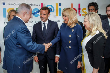 French President Emmanuel Macron (C), looks at his wife Brigitte Macron (2-R) , shaking hands with Israeli Prime Minister Benyamin Netanyahu (L) and his wife Sara Netanyahu (R)  during the opening ceremony of the France-Israel season event in Paris, France, 05 June 2018.
