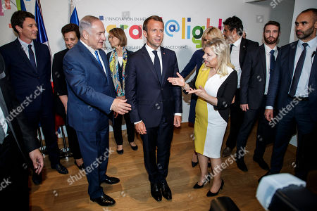 French President Emmanuel Macron (C), Israeli Prime Minister Benyamin Netanyahu (L) and his wife Sara Netanyahu (R) pose during the opening ceremony of the France-Israel season event in Paris, France, 05 June 2018.