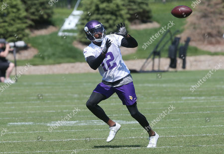 Minnesota Vikings wide receiver Tavarres King receives a pass at the NFL football team's training camp in Eagan, Minn