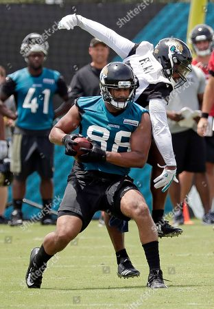 Austin Seferian-Jenkins, Blair Brown. Jacksonville Jaguars tight end Austin Seferian-Jenkins, left, makes a reception as he is defended by linebacker Blair Brown during a scrimmage in an NFL football practice, in Jacksonville, Fla