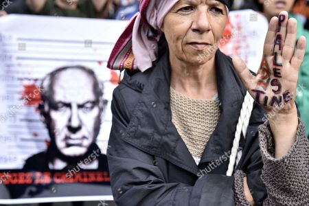 A demonstrator has 'Palestine' written on her hand during a pro Palestinia protest against Israel Prime Minister Benyamin Netanyahu's visit on the Champs Elysees avenue in Paris, France, 05 June 2018. French President Emmanuel Macron and Israeli Prime Minister Benjamin Netanyahu had a meeting at the Elysee Palace.