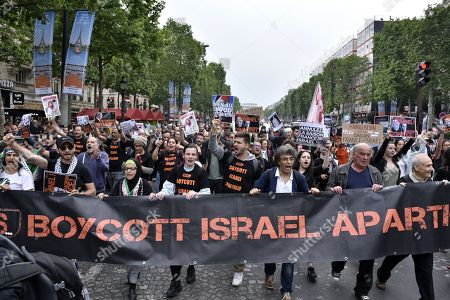 Demonstrators shout slogans against Israel Prime Minister Benyamin Netanyahu's visit during a pro Palestinian protest on the Champs Elysees avenue in Paris, France, 05 June 2018. French President Emmanuel Macron and Israeli Prime Minister Benjamin Netanyahu had a meeting at the Elysee Palace.