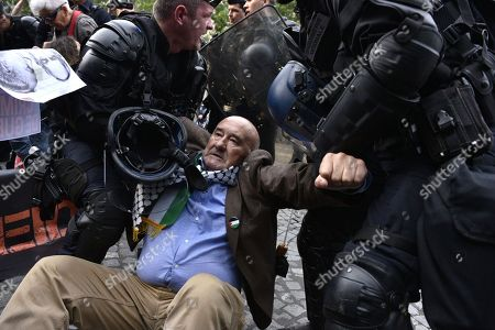 A demonstrator is evacuated by riot police during a pro Palestinia protest against Israel Prime Minister Benyamin Netanyahu's visit on the Champs Elysees avenue in Paris, France, 05 June 2018. French President Emmanuel Macron and Israeli Prime Minister Benjamin Netanyahu had a meeting at the Elysee Palace.