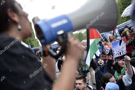 Stock Photo of Demonstrators shout slogans against Israel Prime Minister Benyamin Netanyahu's visit during a pro Palestinian protest on the Champs Elysees avenue in Paris, France, 05 June 2018. French President Emmanuel Macron and Israeli Prime Minister Benjamin Netanyahu had a meeting at the Elysee Palace.