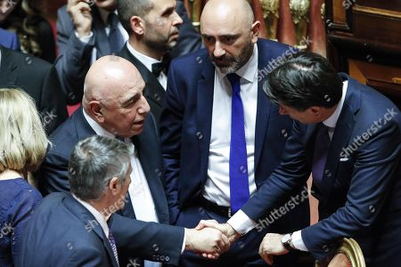 Stock Image of Senator Adriano Galliani (L) shakes hands with premier Giuseppe Conte as they celebrate a confidence vote in the Senate in Rome, Italy, 05 June 2018. Italy's populist government won the first confidence vote with 171 and the alliance received 171 votes in favor, 116 against and 25 abstentions, well beyond the minimum votes needed to pass the Italian Senate.