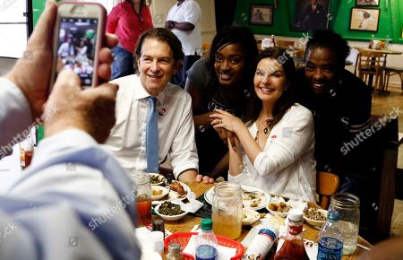 Howard Sherman, Sela Ward. Howard Sherman, Democratic candidate for his party's nomination for the U.S. Senate seat held by Republican U.S. Sen. Roger Wicker, and his wife, actress Sela Ward, pose with a couple of employees at Gloria's Family Restaurant in Jackson, Miss., during a campaign working lunch, . Sherman and his wife campaigned through central Mississippi, stumping for votes in today's party primary