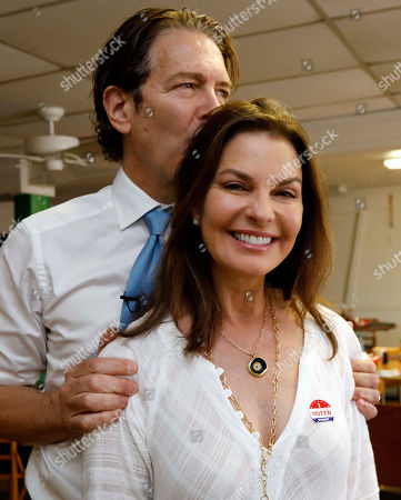 Howard Sherman, Sela Ward. Howard Sherman, Democratic candidate for his party's nomination for the U.S. Senate seat held by Republican U.S. Sen. Roger Wicker, kisses the back of the head of wife, actress Sela Ward, as they await being interviewed in Jackson, Miss., during a campaign working lunch, . Sherman and his wife campaigned through central Mississippi, stumping for votes in today's party primary