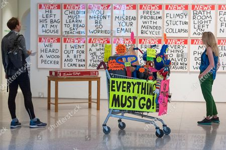 Stock Photo of 'Closing Down Sale' by Michael Landy RA in front of a set of screen prints 'Untitled' by David Shrigley